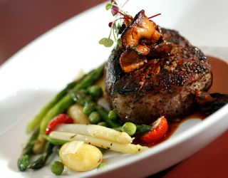 Harrsi Ranch Filet Mignon with scattered spring vegetables