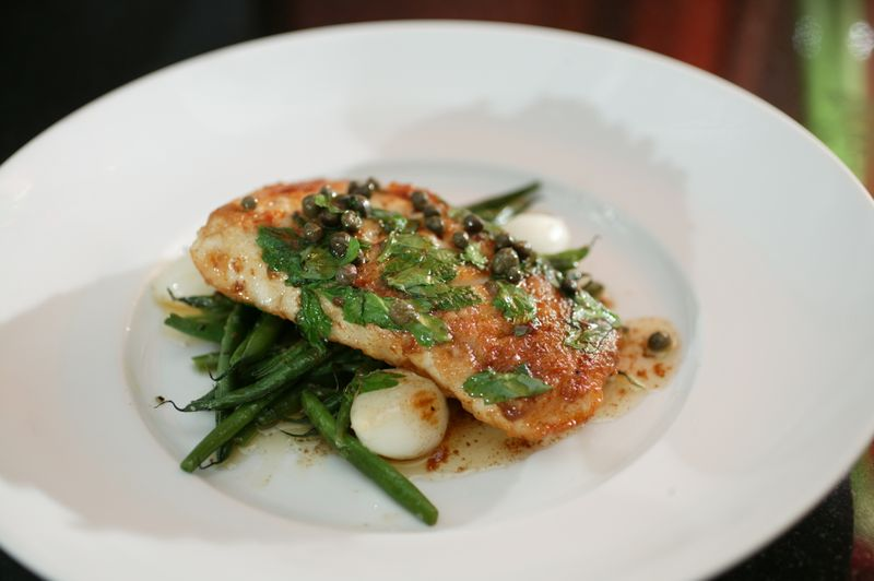 A simple halibut with wilted parsley capers and brown butter